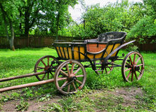 Old wooden horse Carriage. In the garden Royalty Free Stock Image
