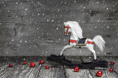 Old wooden horse - shabby chic Christmas decoration - background. Old wooden horse - shabby chic or country style Christmas decoration - background for a royalty free stock photography