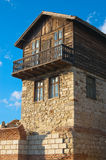 Old wooden house. Wooden house made on top of the stone house royalty free stock photo
