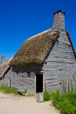Old wooden house. With straw roof stock photo