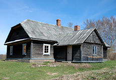 Old wooden house. With asbestos roof stock photo