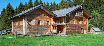Old wooden house. On a background of blue sky Royalty Free Stock Photo