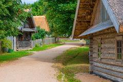 Old wooden house from a bar in  village Royalty Free Stock Photography