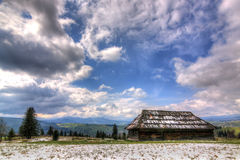 Old wooden house in the bright sky Carpathian Stock Photos