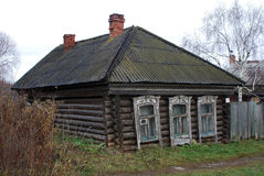 Old wooden house buried in the ground Royalty Free Stock Photo