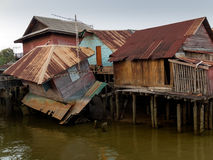 Old wooden house at the canal collapse Stock Photography