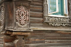 Old wooden house with carved decoration Stock Photo