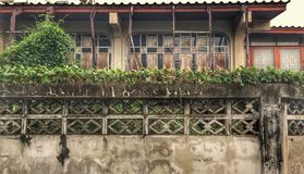 Old wooden house. With cement wall and ornamental on the wall stock photography