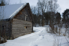 Old wooden house covered by snow Royalty Free Stock Photography