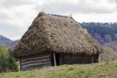 Old wooden house covered with straw Stock Images