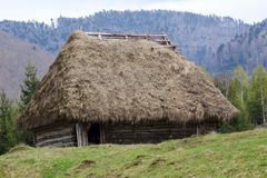Old wooden house covered with straw Stock Photography