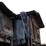 Old wooden house is damaged. Low-angle view of some old wooden houses, decayed, damaged walls with zinc deteriorate Royalty Free Stock Photography