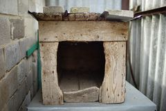 Old wooden dog house. An old wooden house of a dog stock photos