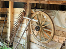 Old wooden house on farm with tools Royalty Free Stock Images