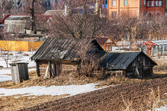 Old wooden house in the field Royalty Free Stock Image