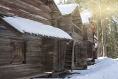 Old wooden house on the Finnish forest in winter.  Royalty Free Stock Images