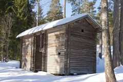 Old wooden house on the Finnish forest in winter.  Royalty Free Stock Image