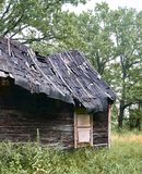 Old wooden house in the forest royalty free stock image