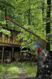 House in the woods. Old wooden house in the forest, with a cart at the door Stock Photography