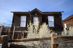 Old Wooden House in Ghost Town. With Blue Sky Stock Photo