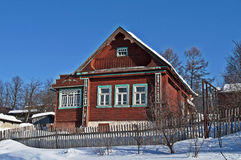 Small wooden house under snow Stock Photos