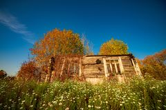 Free Old Wooden House In Fall Landscape Stock Photo - 164064010