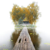 Old wooden house on the lake, foggy autumn morning Royalty Free Stock Photography