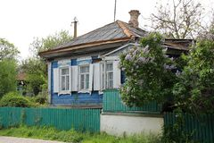 Old wooden house. And a lilac bush Stock Photography