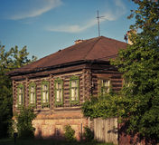 Old wooden house. The old wooden log house in the city summer in the sunlight Royalty Free Stock Photo