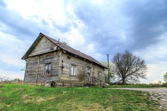 Old Wooden House in Meadow Royalty Free Stock Photography