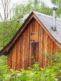 Old wooden house on mountain forest Stock Photo