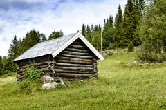 Old wooden house in mountain Stock Photos