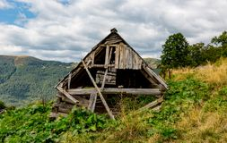 Old wooden house in mountains Stock Photography