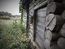 Old wooden house at nature stock photography