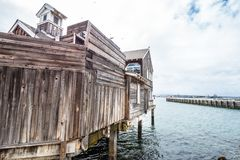 Old wooden house at the oceanfront of San Diego Seaport Village. Travel photography royalty free stock photos