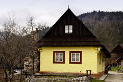 Old wooden house, painted yellow Royalty Free Stock Photos