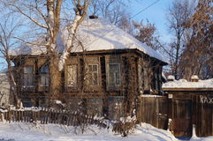 Old wooden house, a resident of Izhevsk. One of the remaining old wooden house of the 19th century the city of Izhevsk with carved platbands Stock Photo
