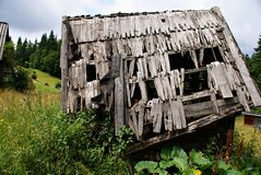 Old wooden house in a  romanian  mountain village Stock Photography