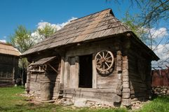 Old wooden house in rural Romania. Old traditional wooden house in Romanian rural area in sunny day Stock Image