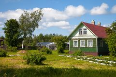 Old wooden house in rural vegetable garden. Russia, Traditional House in old nordic Village Stock Photography