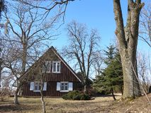 Old house. Old  wooden house in Rusne, Lithuania royalty free stock photos