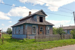 Old wooden house in russian village. Stock Photo