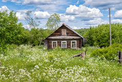 Old wooden house in Russian village Stock Images