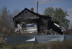 Old wooden house in russian village. Russia. Stock Photos