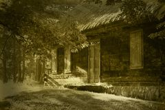 Old wooden house in sepia Royalty Free Stock Images