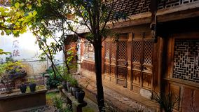 An old wooden house in Shaxi, Yunnan, China. stock photos