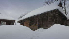 Old wooden house in snow. Carpathians, Ukraine. Snot with slider. stock video