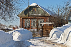 Small wooden house in winter Stock Photos