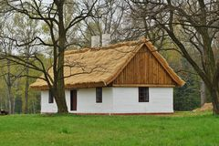 Old wooden house with straw roof Royalty Free Stock Images
