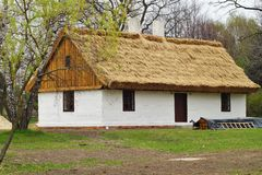 Old wooden house with straw roof Royalty Free Stock Photography